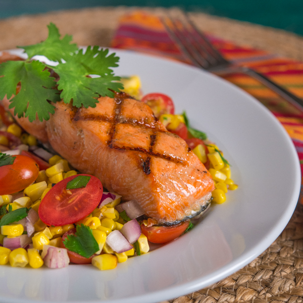 Grilled salmon with corn onions and tomatoes