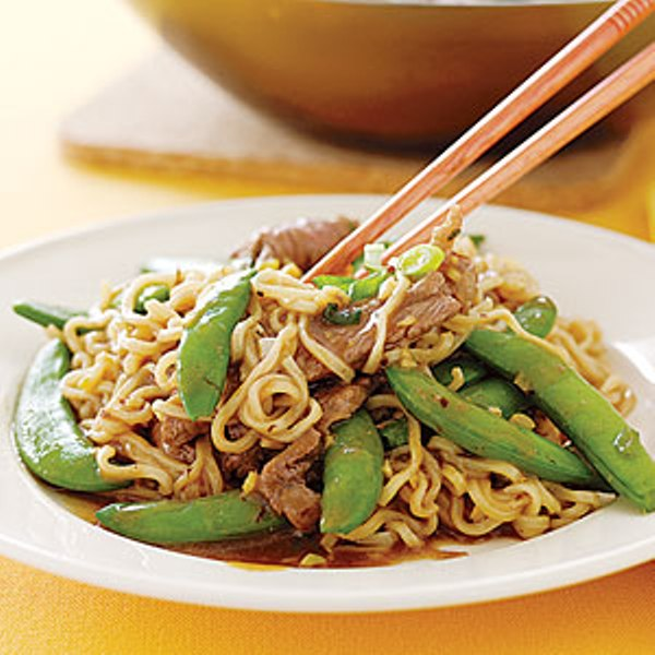 Beef sirloin with spaghetti and snap peas