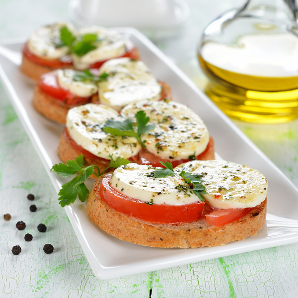 Bruschetta with mozzarella cheese and tomatoes