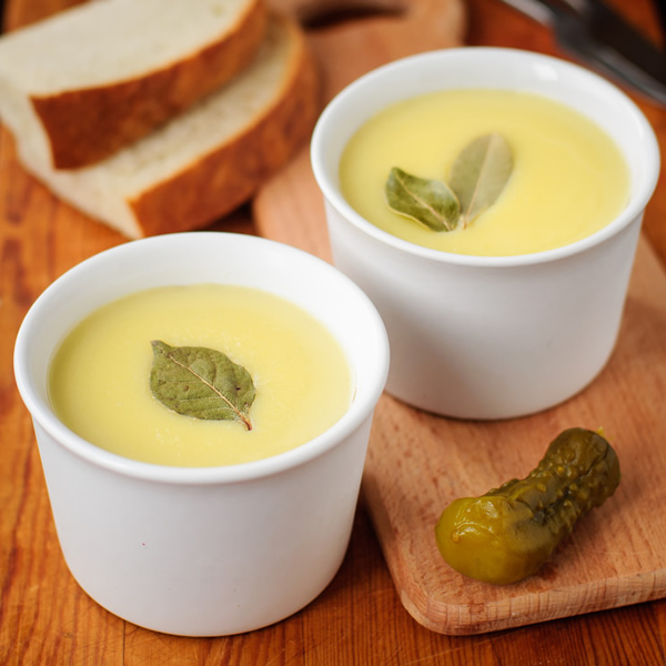 Clarified butter with bread and pickles