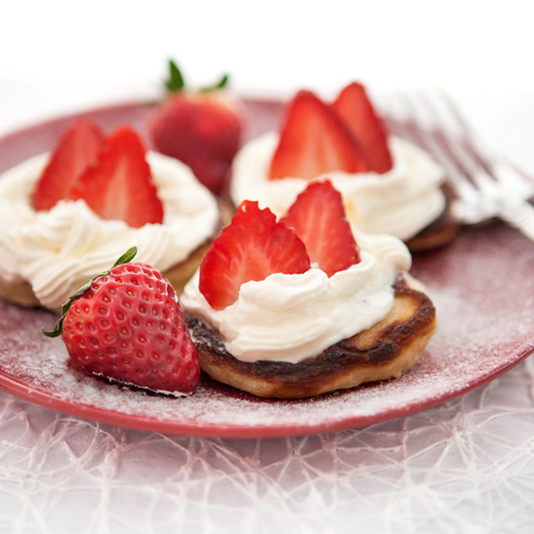 Pancakes with strawberries and whipped cream
