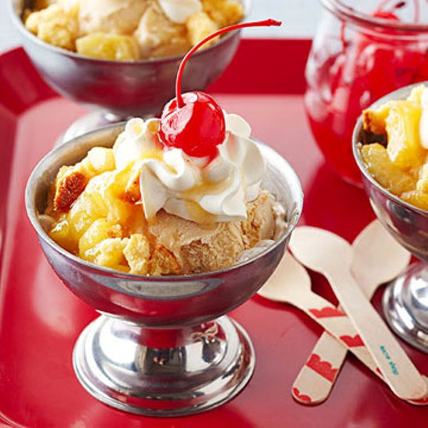 Pineapple sundae with cream and cherries