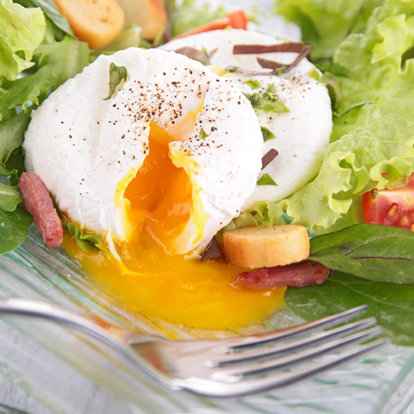 Poached eggs on crispy salad