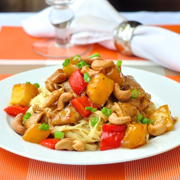 Pork with orange mango and cashew nuts