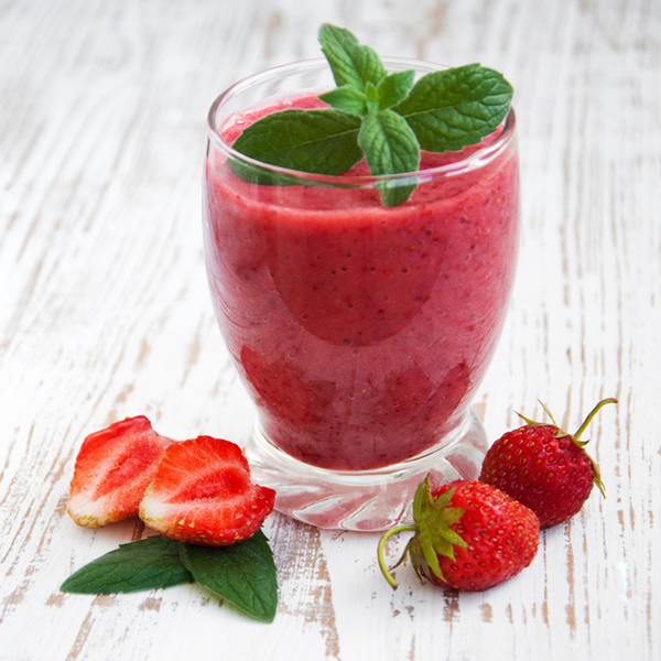 Strawberries spinach and pomegranate smoothie