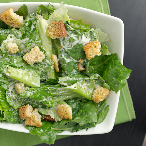 Caesar salad with anchovies dressing and croutons