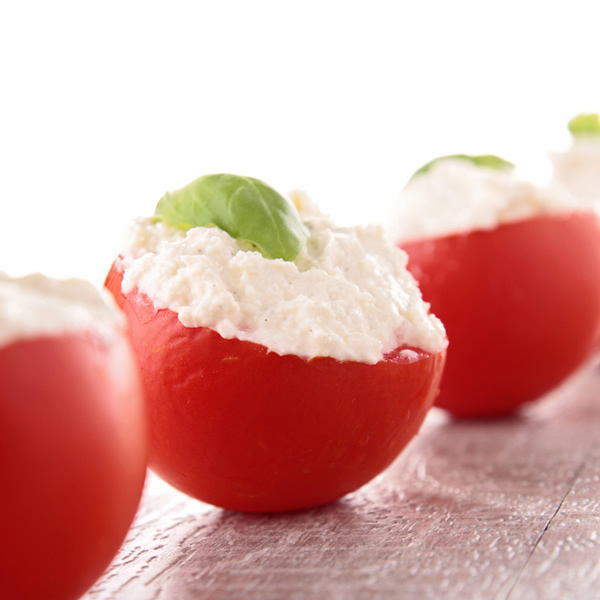 Red tomatoes stuffed with tuna and cream cheese