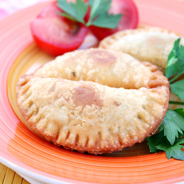 Empanadas with cheese tomatoes and parsley