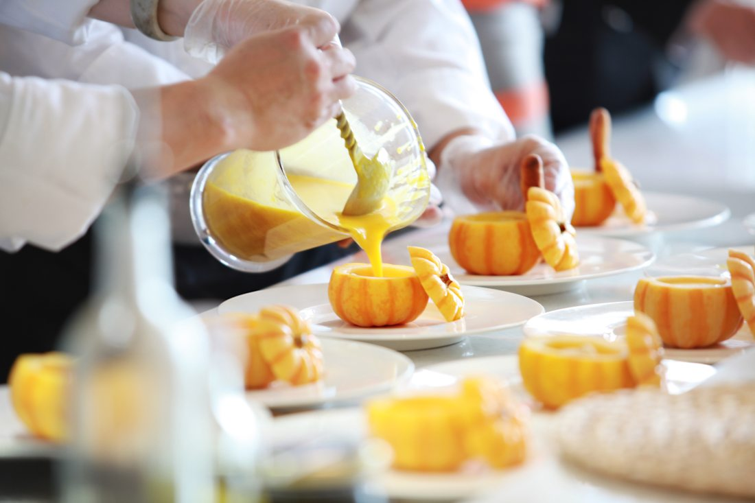 Chef preparing pumpkin soup
