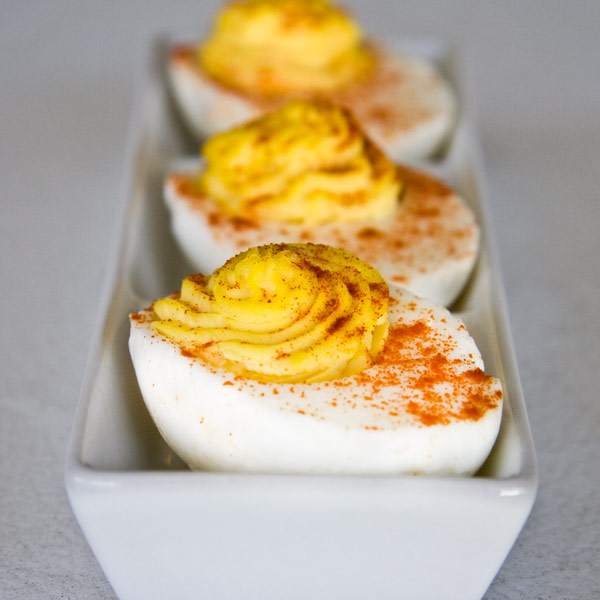 Boiled eggs with cream cheese and spices