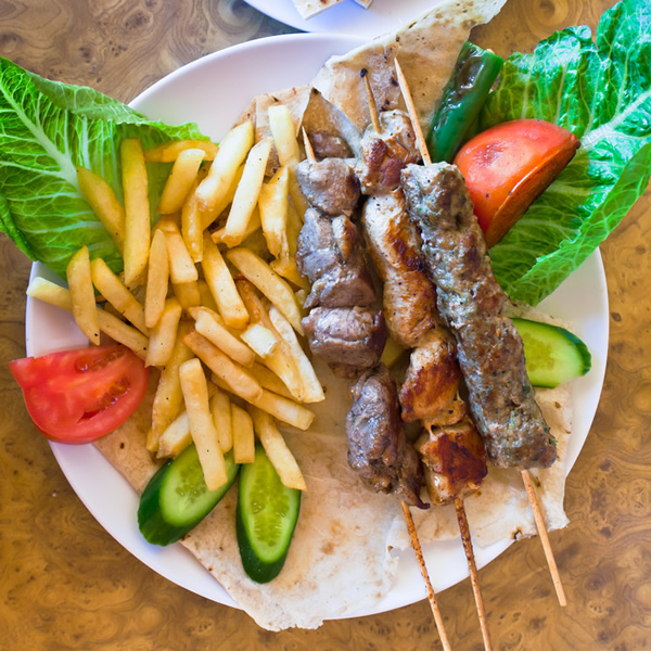 Lamb skewers with fried potatoes